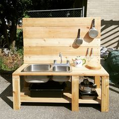 A DIY mud kitchen with reclaimed sink and running water via garden hose connecti. A DIY mud kitche Garden Sink, Diy Garden, Garden Table, Garden Hose, Diy Mud Kitchen, Mud Kitchen For Kids, Garden In The Woods, Backyard For Kids, Play Houses