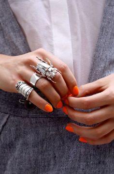 big rings. neon nails.