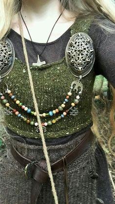 Viking woman's jewellery detail.