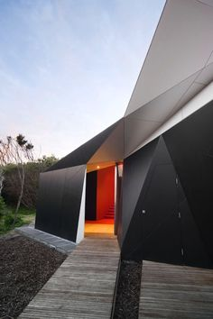 ...ultra modern... triangulated house exterior I think this design could be fabulously melded with stone official house design