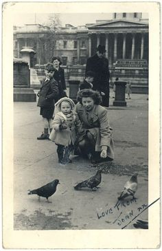 Joan MacLachlan feeding the pigeons in Trafalgar Square, London, 1947.