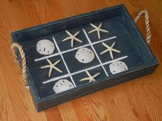 Find a beachy tray and a bag of sand dollars and starfish to make a cute little tic-tac-toe game. Beach Cottage Style, Beach Cottage Decor, Coastal Decor, Nautical Design, Nautical Home, Seashell Crafts, Beach Crafts, Seashell Projects, Diy Projects