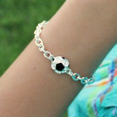 """Are you known as the ultimate """"Soccer Mom"""" in town? Why not play on the title and sport this smashing sports-inspired bracelet at the team's next game. Featuring a charming rhinestone ball and a brigh"""