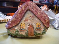 Sue Gerdes- 'Gnome Homes' made from rocks and wood putty and paint. Wood putty is the eves and the chimney.