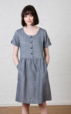 Striped linen, button up dress with pockets.  Kindling Noren Dress, $165.  fair trade - ethical fashion - button front - buttons - dresses with pockets - knee length
