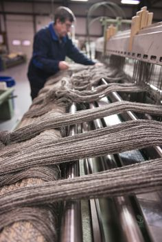 John setting up the Dobby Loom with undyed wool warp at Merida's Fall River, MA mill.