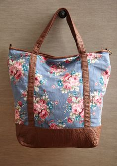 """Katherine Chambray Floral Tote 38.99 at shopruche.com. Perfect for holding all of your essentials in style, this delightful cotton chambray tote boasts a romantic floral print, impossibly soft faux leather accents, and an optional shoulder strap. Finished with a spacious interior compartment and a zipper closure.Shell: 100% Cotton, Lining: 100% Polyester, 12"""" L x 15.5"""" H x 6"""" W, -7.5"""" strap drop, -1 interio..."""