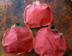 """Apple """"pillows"""" using brown paper grocery bags. ~ wonder if we could make them """"shakers"""" with beans or something inside instead."""