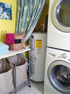 DECOR: LAUNDRY: Love the curtain to hide the utilities!