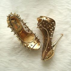 NWT Gold/Clear peep toe spike pumps New with box Gold/Clear peep toe spike pumps. Sold out everywhere! Designer style for a great price! Message me with any questions. Xo POSH Shoes Heels