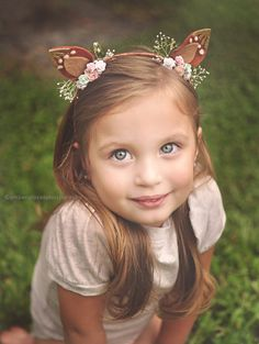 These beautiful handmade fawn ears are perfect for any imaginative little one! They are adorned with flowers and the perfect amount of sparkle!