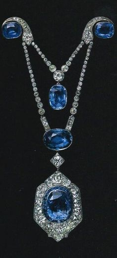 "Cartier broche draperie belonging to Marie-Emilie, countess Esterházy (1913), set in platinum, gold, old-cut round diamonds, five cushion-shaped sapphires for a total weight of 39,66 carats. Cartier named ""broche draperie"" those pendant brooches formed by two elements joint together by a pin, to which the pendant would be suspended, originally a ""guirlande"" style drape."