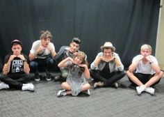 'So I not a fan of one direction, but my little sister is. She recently went to a concert and had a sound check ticket which came with a meet and greet. So she hugged them and said hi to all of them, and then asked if they could all sit on the ground and take a picture with them doing the pose above. Without a moment of hesitation they happily obliged. Now like I said I don't like their music, but I like when people are nice to my little sister.'