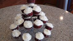 Red velvet cupcakes with cream cheese icing & coconut top