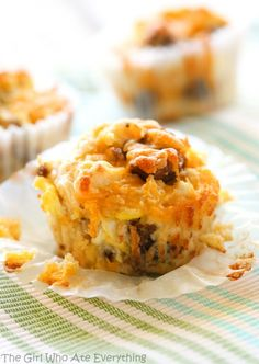 On-the-Go Breakfast Muffins - sausage and egg muffins that can be made ahead and great for on-the-go early weekday mornings. the-girl-who-ate-everything.com