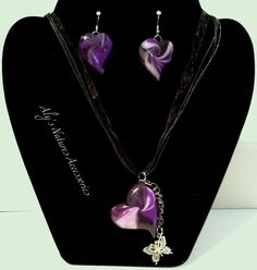 """This is a handmade polymer clay Swirled Purple Heart with an attached silver butterfly. The main Heart is 1 1/2"""" x 1 1/2"""" and only weighs .07oz    The matching swirl hear earrings only weigh .2oz each    on a 18 inch adjustable black organza ribbon necklace cords with a lobster clasps."""