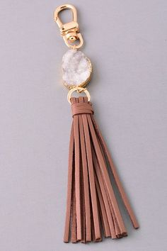 Add a little sparkle to your keys, AND make them easier to find. That's a win-win in my book! - Light gray druzy keychain, with a brown tassel and gold hardware. - 7.5 inches long from top to bottom.