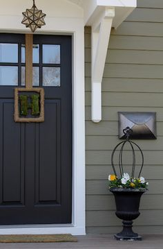 Grey siding, white trim, black door color palette -- exterior siding is Crownsville Gray by Benjamin Moore.DOOR is painted Benjamin Moore's Aura exterior in black. Exterior Siding, Exterior Remodel, Exterior Design, Interior And Exterior, Gray Exterior, Brick Siding, Bungalow Exterior, Modern Exterior, Exterior Paint Colors For House