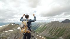 Hiker With Backpack Standing On Top Of a Mountain With Raised Hands And Enjoying Sunrise #Cliff, #Extreme, #Freedom, #Hike, #Hiking, #Hill, #Journey, #Mountain, #Peak, #Relaxing, #Sibstock, #Success, #Top, #Tourist, #Travel, #Young https://goo.gl/r7Umoh