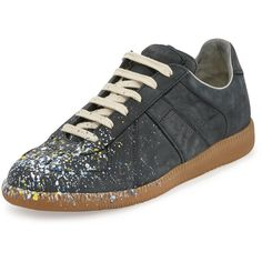 Maison Margiela Paint Splatter Leather Sneaker ($695) ❤ liked on Polyvore featuring shoes, sneakers, black pain, leather shoes, black trainers, low profile sneakers, low heel shoes and black low heel shoes