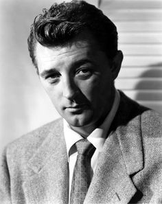Robert Mitchum - not conventionally handsome, but it was the whole package that made him attractive...