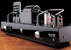 """he Vintage iPod Tube Amp/Charger has the cool somewhat steampunk/Sci-Fi look of a mad scientists lair. According to the manufacturer, you ca enjoy your playlists with the """"warmth and richness only a vintage tube amplifier can provide""""."""