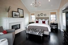 Dark hardwood floors; black, white, zebra, gray, red accents