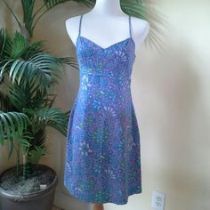 """Floral Batik Pattern Sundress Super cute and in flawless condition. Base color is lavender, with turquoise blue, bright green, and bright white teeny weeny outline dots. Fully lined. Kick/split in back. Approx measurements: U-U 17"""" across, empire waist 15"""" across, hips 20"""" across, length from top of spaghetti strap to hem 37"""". Also available in an overall pink color in a separate listing, exact same size and measurements. Body 100% cotton, lining (which is white) 55% poly, 45% cotton. Tibi…"""
