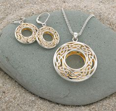 "Window to the Soul Jewelry reflects the shining infinite spirit inside you. On the exterior, an unending double ring of silver eternal knotwork. The interior reveals the heart of gold shining through. Sterling silver gilded with 24k gold; gift-boxed. Pendant on 18"" chain. Designed by Irish jeweler Keith Jack."