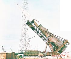 A Soviet N-1 rocket being raised over its launchpad. After four unsuccessful launch tries of the Soviet counterpart to the NASA Saturn V rocket, the Russian Moon program was cancelled in May 1974.