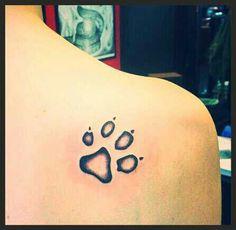 Paw print tattoo..... I want it.