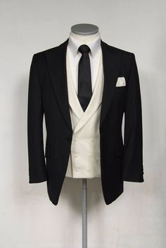 Slim Fit Black Lounge Suit with a Ivory Double Breasted  Waistcoat, Black Tie with a White Pocket Square