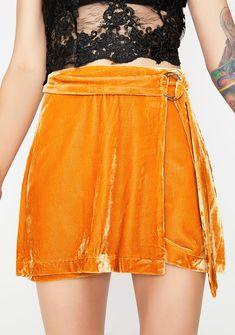 Tastes Like Honey Velvet Skirt cuz they love them some honey. This velvet wrap skirt has a mini fit and an O-ring detail.