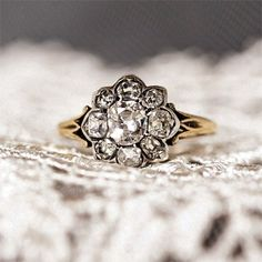 LOVE this ring!- the gold is not tacky shiny- it looks antique! and it doesn't show the little tabs holding onto each piece of the flower.. now just change the diamonds to sapphire and we're set hahaha