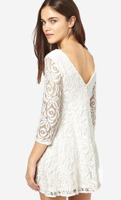 Made from a cotton-rich lace. Sheer floral lace overlay. Boat neckline. Bracelet sleeves. V-back. Regu...