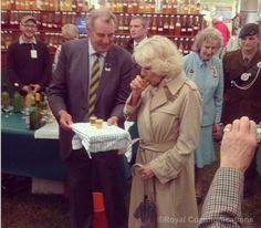 The Duchess of Cornwall samples some local cider at the Royal Bath and West Show. 28 May 2014.