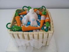Easter cake - White chocolate mud cake with white Kit Kat all around,M and Lindt chocolate carrots.Just a quick cake for all the kids...