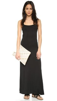 A minimalist CLAYTON maxi dress with a breezy back cutout. The raw hem adds an undone touch. Sleeveless. Unlined.