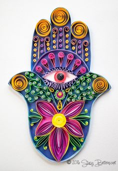 Quilled Hamsa Hand A couple of nights ago I asked my niece what she thought I should make next. At first she suggested a fairy. I searched high and low for a fairy that looked like it would lend we…