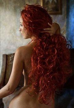 Beautiful curly red hair Makes me think mermaid sort of.