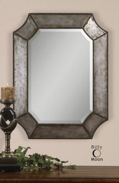 elliot wall mirror, frame made of distressed, hammered aluminum with burnished edges and rustic bronze details