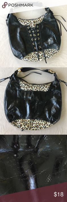 Faux Black Leather Corset Purse w/Animal Print Faux Black Leather Corset Purse w/Animal Print and Gold Accents. Fits securely under arm when worn on shoulder . Benefit Bags Shoulder Bags