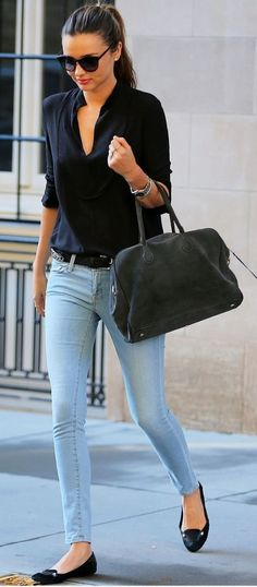 Miranda Kerr Simple style: skinny jeans with Charlotte Olympia kitty flats, a black button down, and black bag