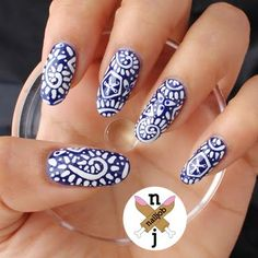 This Manicure Uses Dark Blue Nail Polish As Base And White Acrylic Paint To Create The