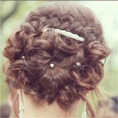 Prom up do hair with braid, sparkle pins and clip.