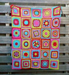 pretty granny squares-- I LOVE the colors!! I would put this on my to do list but who am I kidding?! :)