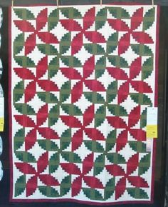 Interesting variation of curved Log Cabin blocks in two colorways.