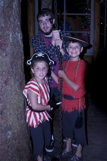 DIY Pirate Costume hats, stripes, cut in small triangles at bottom, most sleevless, belt, sword, and dark pants cut at bottom (rips and holes?).