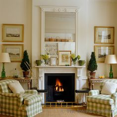 Todhunter Earle Interiors ~ A pair of armchairs, upholstered in green and cream checked fabric, flank the fireplace of this neutrally decorated living room