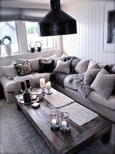 In love with the couch and how comfortable it looks. I wouldn't have as much going on in the windows and coffee table but definitely sold on the couch and the warmth it brings.